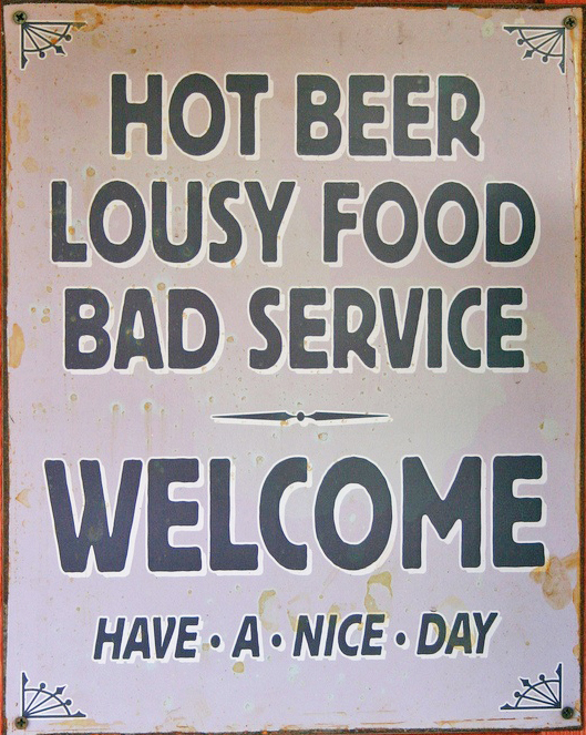 Restaurant Sign: Hot Beer. Lousy Food. Bad Service. Welcome. Have a nice day.