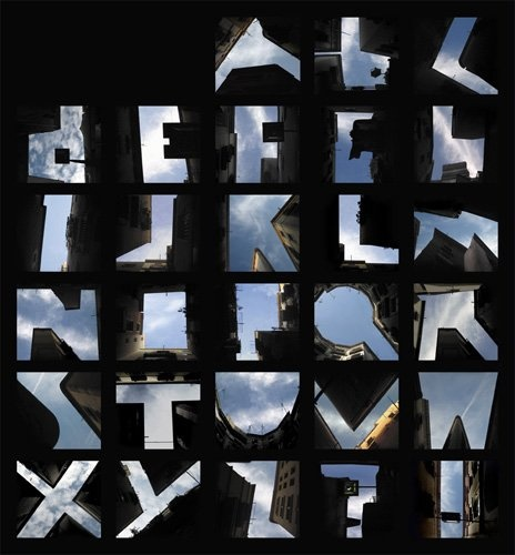 Photograph of letter shapes formed by the sky and tall buildings.