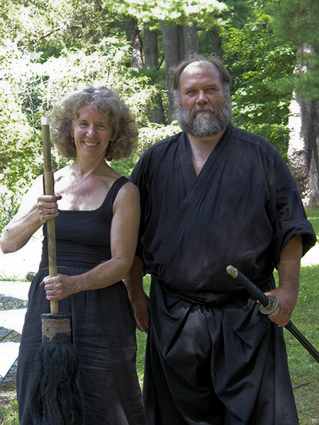 Barbara Bash with a big brush and Bob WIng with this sword